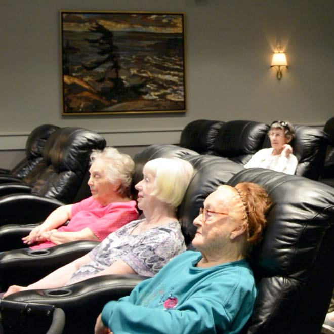 Ross Place Our Story Our Vision Card Seniors Watching Movies In Theatre